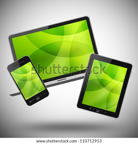 Tablet pc, mobile phone and notebook on gray background