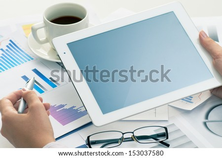 tablet pc on the working table - stock photo