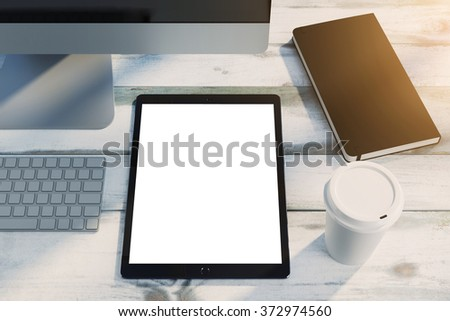 tablet pc on wooden desk, mockup of blank screen device, hipster workspace. 3d render