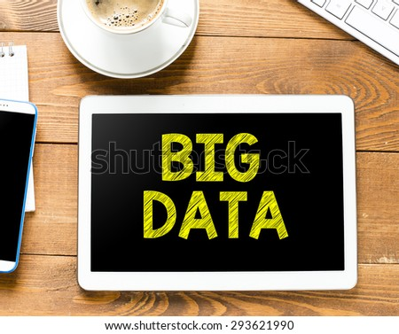 Tablet pc with big data and coffee - stock photo