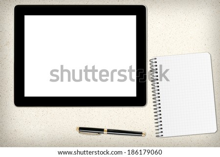 Tablet pc with blank screen and pen over table. - stock photo