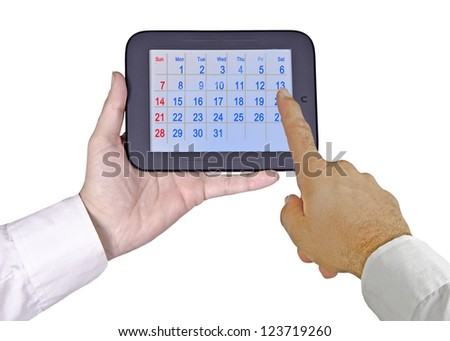 Tablet PC with calendar - stock photo