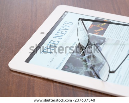 Tablet PC with newspaper application and glasses