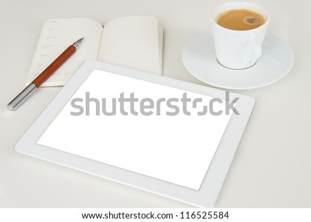 tablet pc with notebook and cup of coffee - stock photo