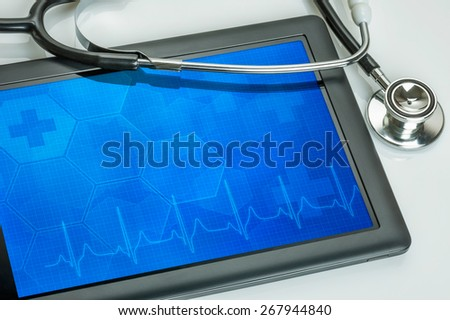 Tablet pc with stethoscope - stock photo