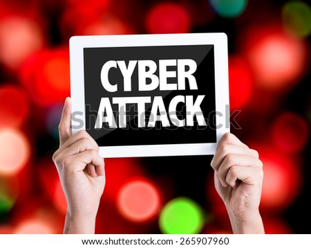 Tablet pc with text Cyber Attack with bokeh background - stock photo