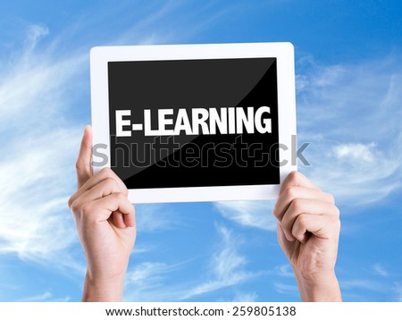 Tablet pc with text E-Learning with sky background  - stock photo