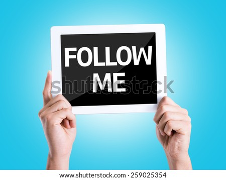 Tablet pc with text Follow Me with blue background - stock photo