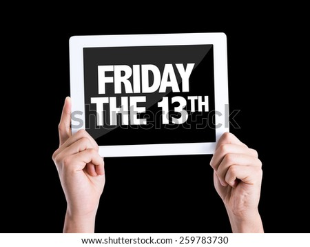 Tablet pc with text Friday The 13th isolated on black background - stock photo