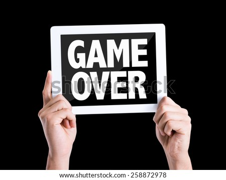 Tablet pc with text Game Over isolated on black background - stock photo