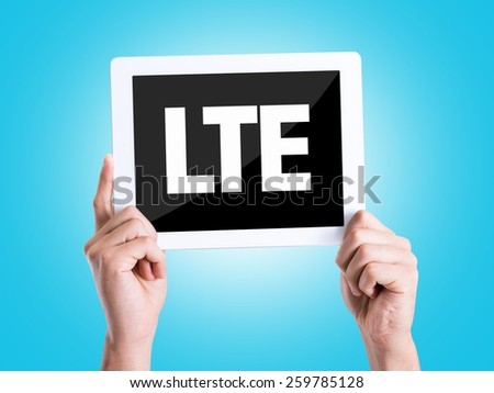 Tablet pc with text LTE with blue background - stock photo
