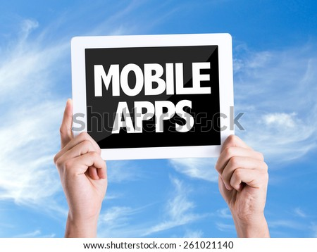 Tablet pc with text Mobile Apps with sky background - stock photo