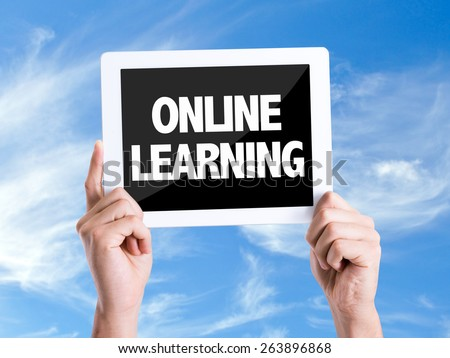 Tablet pc with text Online Learning with sky background - stock photo