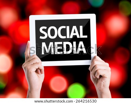 Tablet pc with text Social Media with bokeh background - stock photo