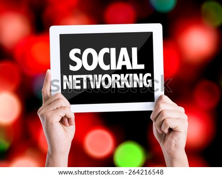 Tablet pc with text Social Networking with bokeh background - stock photo