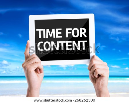 Tablet pc with text Time For Content with beach background - stock photo