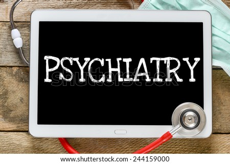 Tablet pc with word Psychiatry. Tablet pc with word Psychiatry and stethoscope, medicine concept - stock photo