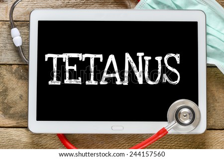 Tablet pc with word Tetanus. Tablet pc with word Tetanus and stethoscope, medicine concept - stock photo