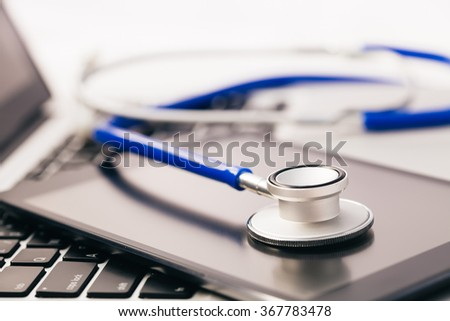 Tablet / Phablet being diagnosed by stethoscope - phone repair and check up concept