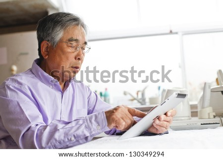 Tablet, senior - stock photo
