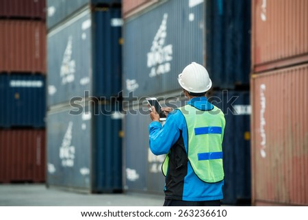 Tablet to handle export and import goods prepare the delivery of rubber compactos in port. - stock photo