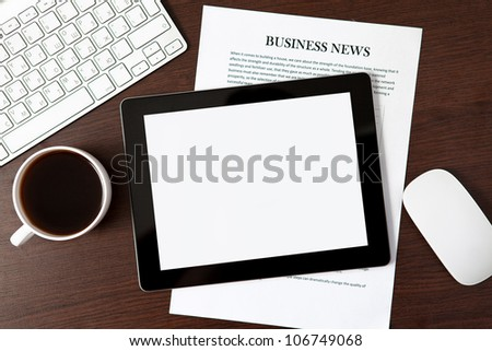 tablet touch computer gadget on the table of a businessman - stock photo