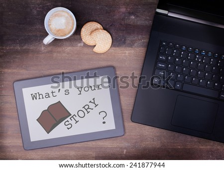 Tablet touch computer gadget on wooden table, what's your story, vintage look - stock photo