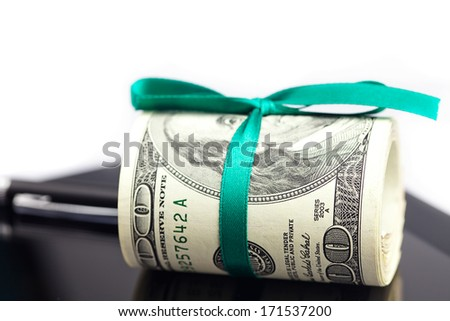 tablet,tube of dollars and stylus isolated on white - stock photo