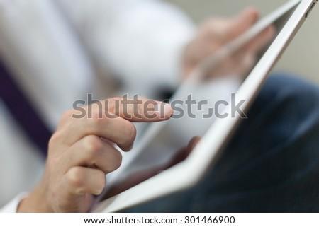 Tablet, using, laptop. - stock photo
