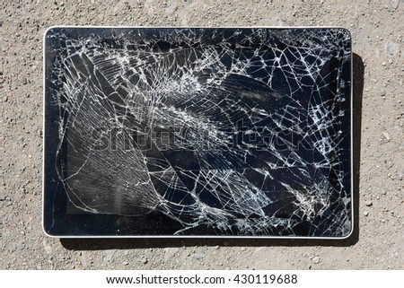 tablet with broken display on road