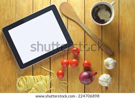Tablet with food ingredients  - stock photo