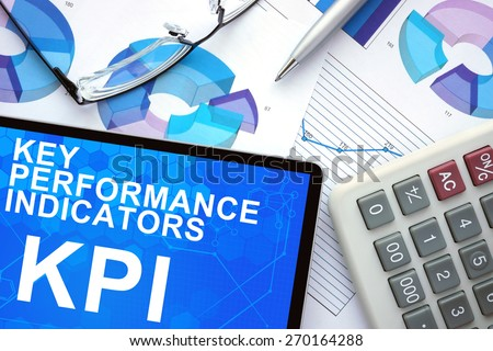 Tablet with Key Performance Indicators  , KPI , graphs and calculator.  - stock photo