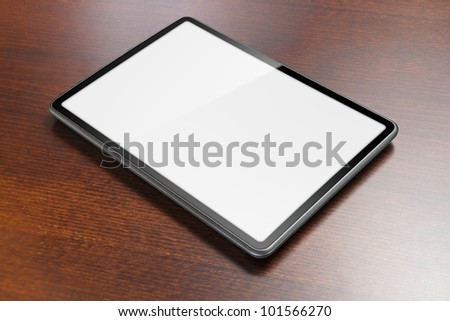 Tablet with screen as copy space laying on table. - stock photo