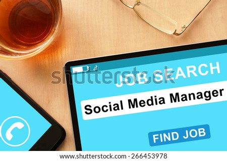 Tablet with Social Media Manager  on  job search site. - stock photo