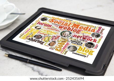 tablet with social media word cloud - stock photo