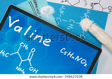 Tablet with the chemical formula of Valine - stock photo