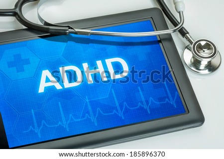 Tablet with the diagnosis adhd on the display - stock photo