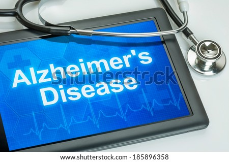 Tablet with the diagnosis alzheimer's disease on the display - stock photo