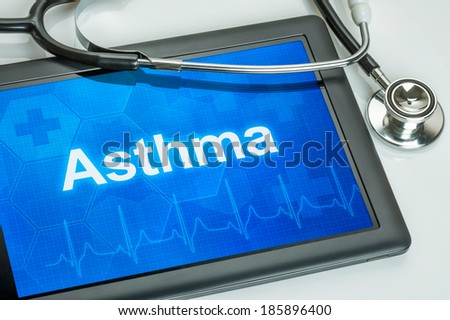 Tablet with the diagnosis asthma on the display - stock photo