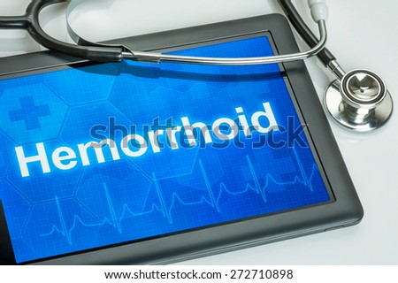 Tablet with the diagnosis Hemorrhoid on the display - stock photo