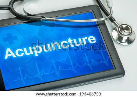 Tablet with the text Acupuncture on the display - stock photo