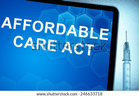 Tablet with words  Affordable Care Act and syringe - stock photo