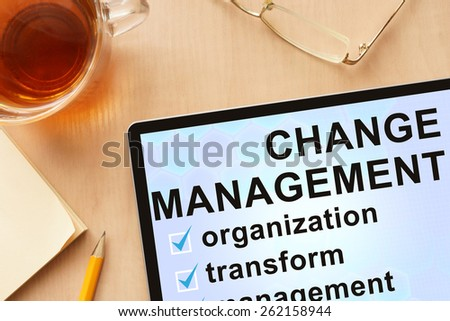 Tablet with words change management. Business concept. - stock photo
