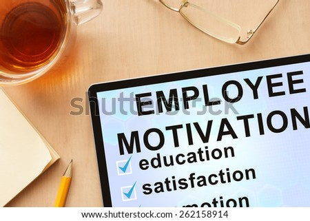 Tablet with words employee motivation. Business concept. - stock photo