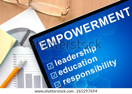 Tablet with words empowerment. Business and management concept. - stock photo