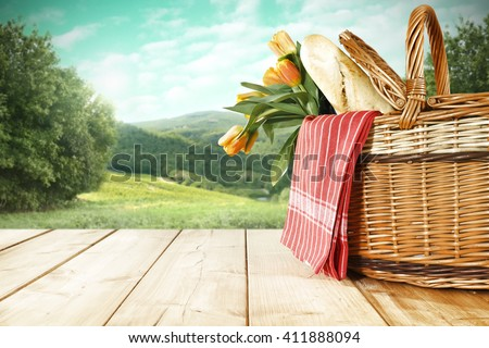 tabletop background of big basket of flowers and napkin and bread  - stock photo