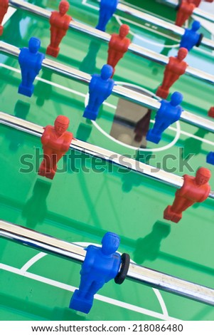 Tabletop football with red and blue figures - stock photo