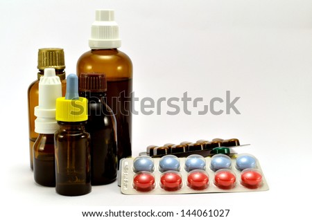 tablets and dark jar on a white background