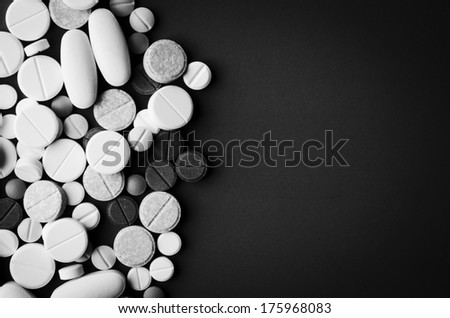 tablets and pills on dark background