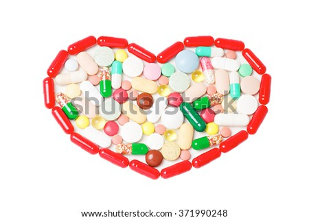 Tablets, capsules, pills in heart shape